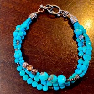Turquoise and silver three strand beaded bracelet